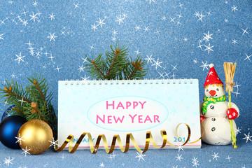 Calendar, New Year decor and fir tree on blue background