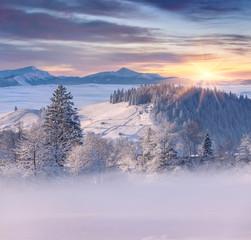 Wall Mural - Beautiful winter sunrise in mountain village