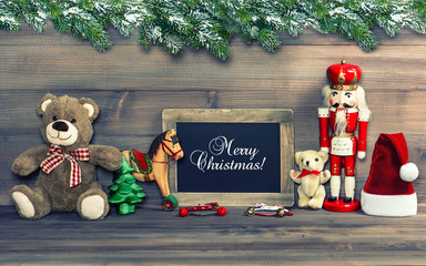 christmas decoration with antique toys and blackboard