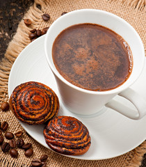 Cup of coffee and biscuits with poppy seeds