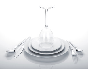 Silverware or flatware set and wine glass over plates