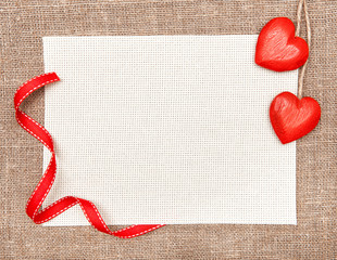 Valentine card with wooden hearts and canvas