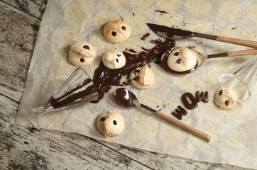 Wall Mural - Funny meringue with chocolate on baking paper