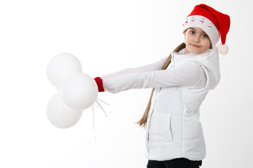 Happy Beautiful Girl in Santa Hat holding white balloons