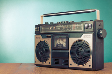 Retro ghetto blaster cassette tape recorder on table