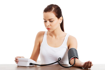 young woman doing blood pressure test.