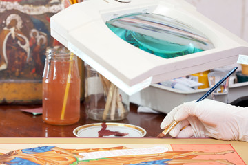 Icon-painter  works on new Christian icon