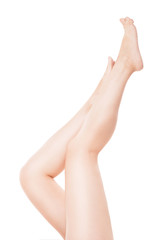 Beautiful woman legs isolated over white