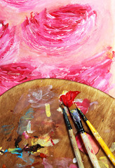 Paintbrush and beautiful painting with flowers