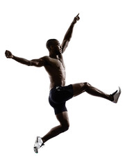 Wall Mural - young african muscular build man jumping running  silhouette