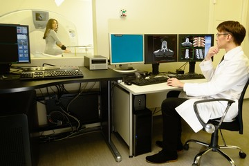 Doctor with woman patient  at the computed tomography