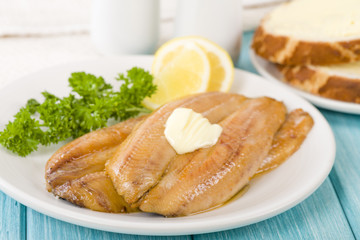 Smoked Kippers - Butterfly smoked herring served with bread.
