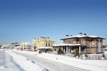 Street in small cottage settlements in winter frosty and sunny