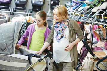 pregnant woman chosing pram