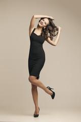 Beautiful girl in a fashionable dress.  Brunette, long hair. pas