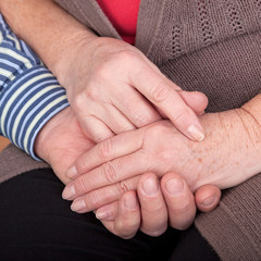 Mature couple holding their hands