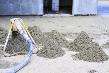 Construction site - machine running screed flooring