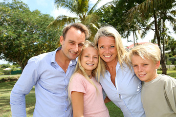 Portrait of happy family standing outside