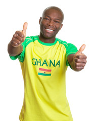 Sports fan from Ghana showing both thumbs