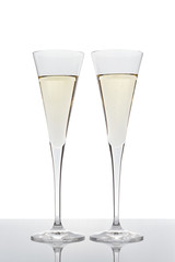 Two glasses of champagne isolated on white.