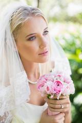 2eb5dffbc289b Smiling blonde bride in pearl necklace holding orange rose - Buy ...
