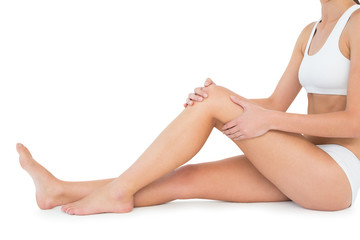 Side view of a fit young woman with knee pain