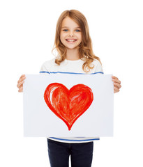 smiling little child holding picture of heart