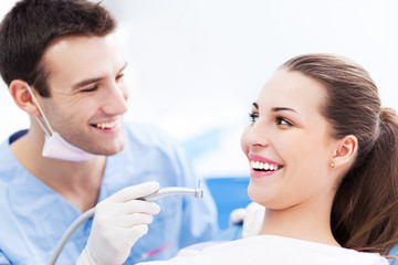 Male dentist and woman in dentist's office