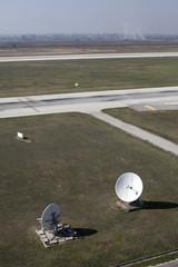 empty airport runway with antennas