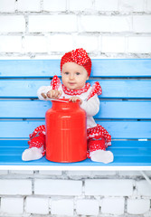 Baby in red costume