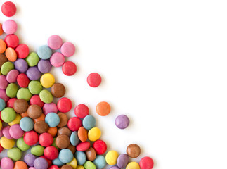 Smarties in corner, white background