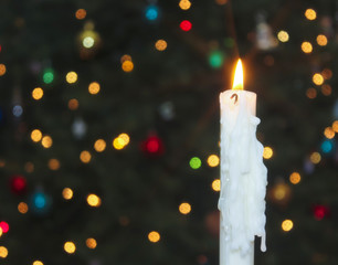 A White Christmas Candle with Blurred Lights