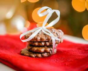 Chocolate cookies on white textile with ribbons