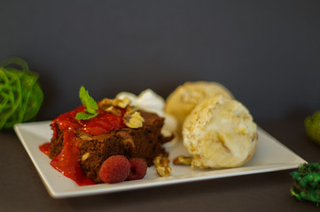 Brownies with ice-cream and raspberries