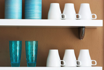 Mugs and cups stored on the shelf