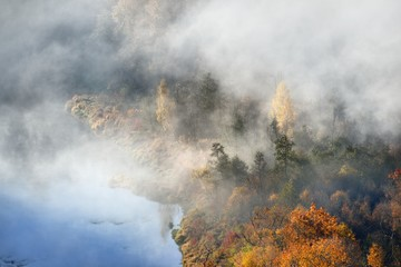 Hills covered with mist in Autumn. Sigulda, Latvia.