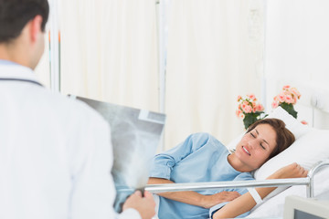 Doctor visiting patient in the hospital