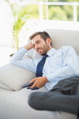 Well dressed man watching tv in living room