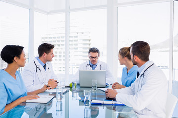 Concentrated medical team around desk