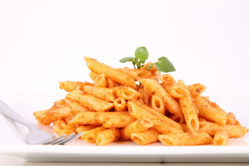 Pasta with pesto rosso decorated with cress