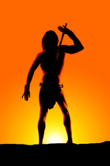 silhouette man loin cloth hand up