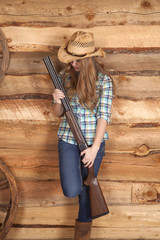 cowgirl shotgun stand by wall
