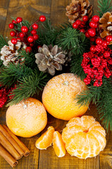 Christmas composition with frosted ripe tangerines