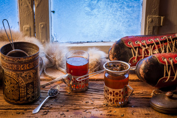 Wall Mural - Warming tea in a winter day