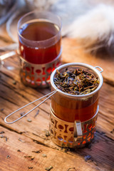 Fototapete - Close-up of warming tea served in old-fashioned