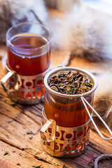 Fototapete - Closeup of hot tea brewed in the strainer