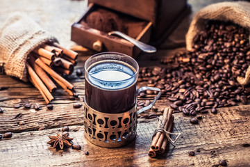 Fototapete - Freshly brewed coffee with the scent of cinnamon