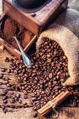 Fototapete - Freshly ground coffee beans in the grinder