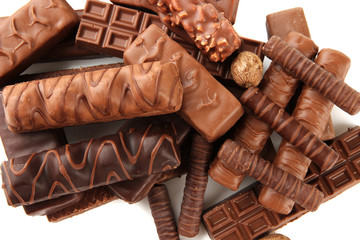 Fototapete - Delicious chocolate bars with nuts close up