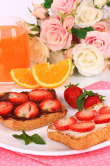 Delicious toast with strawberry on plate close-up